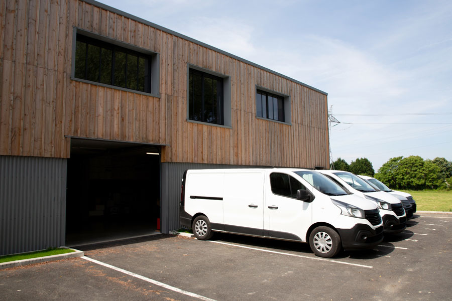 Business Auto Insurance - Fleet of Vans Outside of a Loading Dock