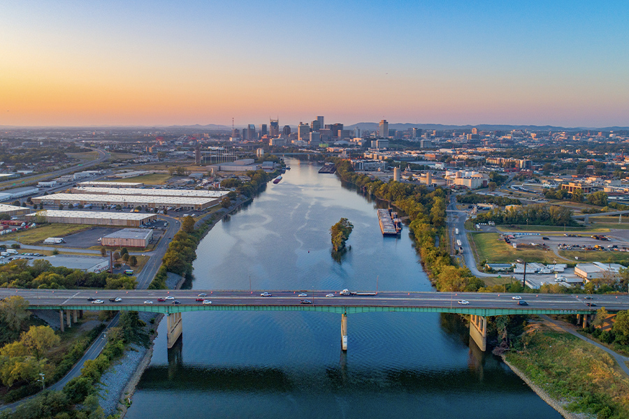 Contact - Aerial View of Nashville Tennessee Skyline, Cumberland River and Surrounding Area
