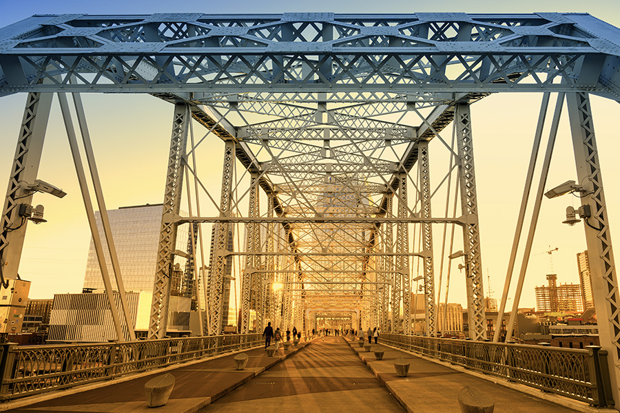 Tennessee - Sunset Shining Thru a Bridge with Buildings in the Background